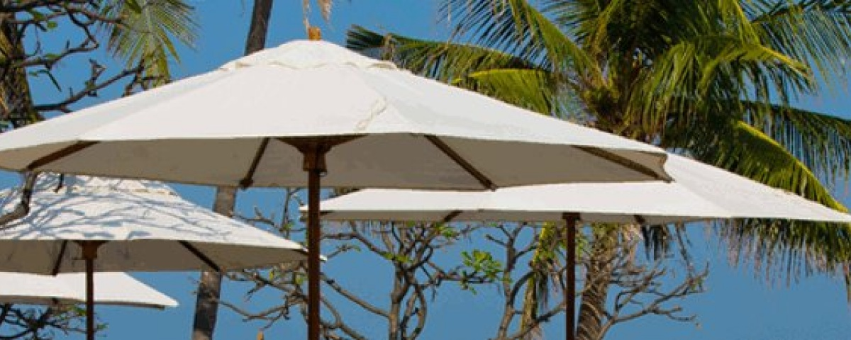 Heavy Duty Market Umbrellas on a poolside restaurant deck - White