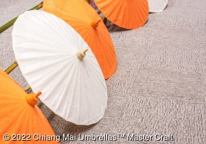 Paper umbrellas in solid orange and white - 85 cm diameter