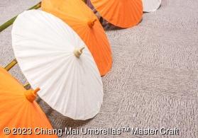 Paper umbrellas in solid orange and white - 85 cm diameter